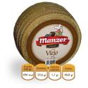 Un vieux mêle du fromage Manchego Manzer 3 kg.